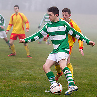 Rhine Rover's Graham O'Connor keeps the ball from Avenue A's Mark Roche