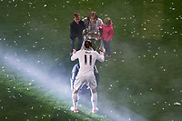 Real Madrid's player Luka Modric with his kids during the celebration of the victory of the Real Madrid Champions League at Santiago Bernabeu in Madrid. May 29. 2016. (ALTERPHOTOS/Borja B.Hojas)