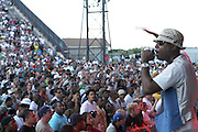 Talib Kweli at The Rock the Bells International Festival Series powered by SandDisk held at Jones Beach on August 3, 2008..Few events can claim to both capture and define a movement, yet this is precisely what Rock The Bells has done since its inception in 2003. Rock The Bells is more than a music festival. It has become a genuine rite of passage for thousands of core, social, conscious, and independent Hip Hop enthusiasts, backpackers, and heads. Following in the colorful tradition and history of past Hip Hop music festivals such as Smoking Grooves and Cypress Hill?s Smoke Out, Rock The Bells is the ultimate Hip Hop platform and premiere music experience in America. Rock The Bells has established a forum of unparalleled diversity and excellence by uniting the biggest names involved with urban culture.