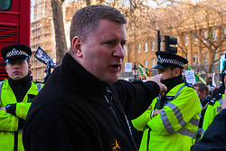 London, February 8th 2015. Muslims demonstrate outside Downing Street  to denounce the uncivilised expressionists reprinting of the cartoon image of the Holy Prophet Muhammad. PICTURED: Britain First leader Paul Golding leads his anti-Islamist group in a counter-protest.