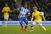 Brighton's Kazenga LuaLua and Derby County's Jamie Ward battle for the ball during the Sky Bet Championship match between Brighton and Hove Albion and Derby County at the American Express Community Stadium, Brighton and Hove, England on 3 March 2015. Photo by Phil Duncan.