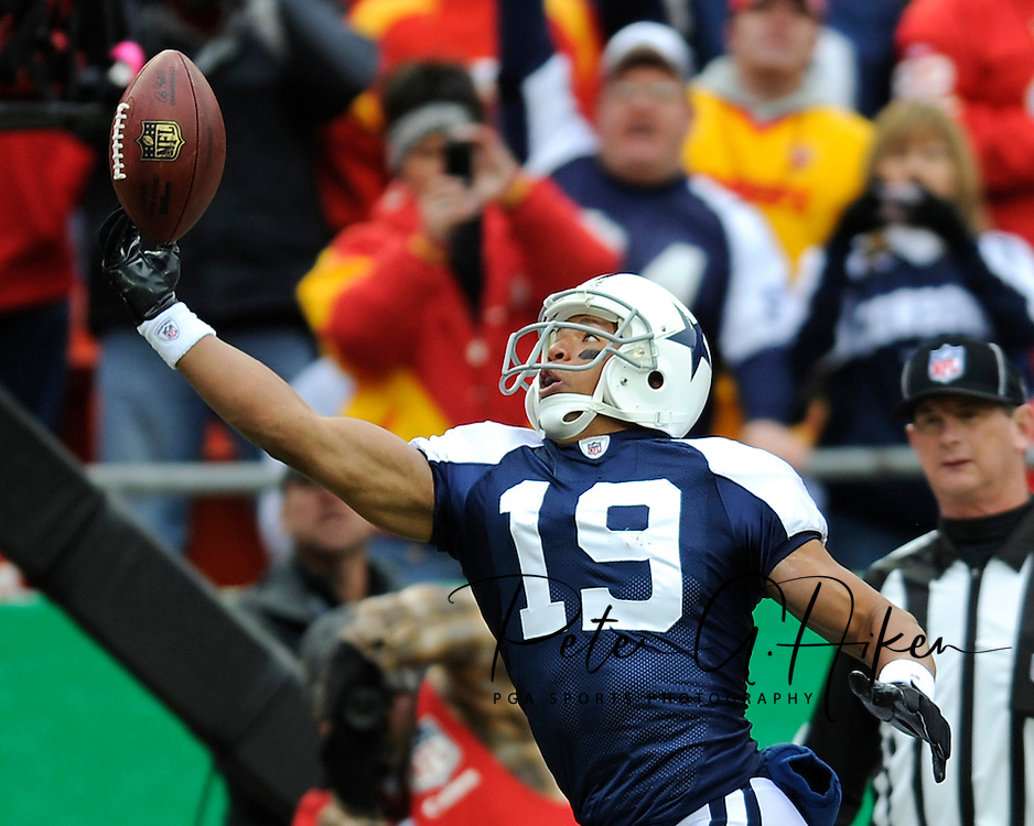 October 11, 2009:  Wide receiver Miles Austin #19 of the Dallas Cowboys reaches out for a pass during a game against the Kansas City Chiefs at Arrowhead Stadium in Kansas City, Missouri.  The Cowboys defeated the Chiefs in overtime 26-20...