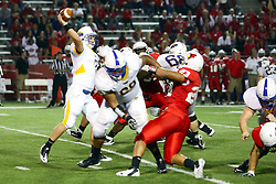 10 September 2011: Austin Davis gets blocked out as Zach Lewis makes a throw during an NCAA football game between the Morehead State Eagles and the Illinois State Redbirds at Hancock Stadium in Normal Illinois.