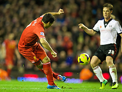 09.11.2013, Anfield, Liverpool, ENG, Premier League, FC Liverpool vs FC Fulham, 11. Runde, im Bild Liverpool's Luis Suarez tries an audacious back-heel shot at goal against Fulham // during the English Premier League 11th round match between Liverpool FC and Fulham FC at Anfield in Liverpool, Great Britain on 2013/11/09. EXPA Pictures © 2013, PhotoCredit: EXPA/ Propagandaphoto/ David Rawcliffe<br /> <br /> *****ATTENTION - OUT of ENG, GBR*****