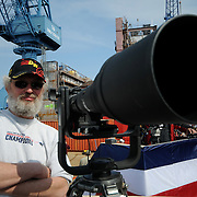 5/7/11 -- BATH, Maine. BIW Photographer on deck of media platform. .. U.S. Navy Destroyer Michael Murphy was christened during ceremonies on Saturday, May 7, 2011 at Bath Iron Works. The 509 foot ship was named for Lieutenant Michael Murphy, whose bravery under fire in Afghanistan in June, 2005 led to the posthumous award of the Medal of Honor..The ceremony included speeches by Maine Governor Paul LePage, Chief of Naval Operations - Admiral Gary Roughead, Senator Olympia Snowe, Representatives Mike Michaud and Chellie Pingree as well as ship sponsor, Maureen and Dan Murphy, parents of Lieutenant Murphy. Photo by Roger S. Duncan.
