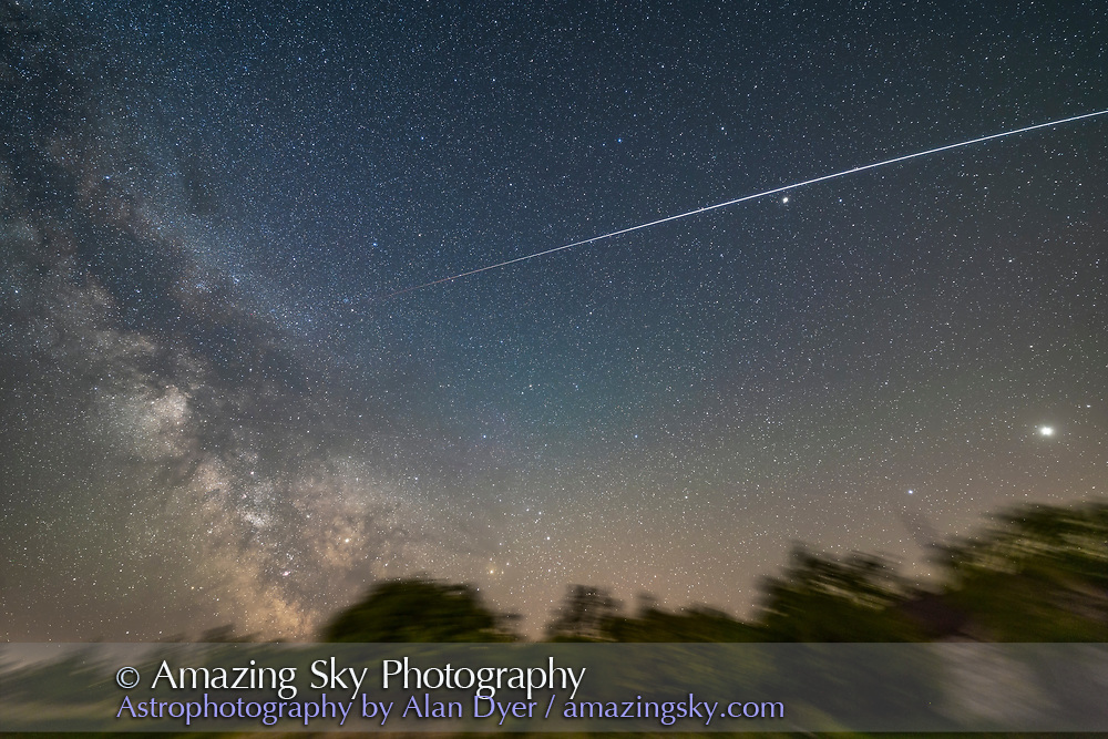The ISS passes into shadow on a pass at about 1:30 a.m. on the morning of May 30, 2017 traveling from west (right) to southeast (left). The trail dims as it enters Earth&rsquo;s shadow and turns red before fading out. The Milky Way is at left. Jupiter and Spica are at far right, Arcturus is the bright star at upper right below the ISS track. <br /> <br /> This is a stack of 5 x 2 minute exposures, tracked, and mean combined to smooth noise, but with the ISS path itself from a single exposure. All with the 14mm Rokinon lens at f/2.5 and Canon 6D at ISO 1250. On the Star Adventurer Mini tracker. Shot from home during testing of the Mini tracker.
