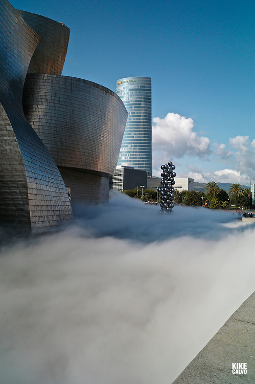 The Sculpture Tall Tree & The Eye by Anish Kapoor, surrounded by The Fog sculpture designed as a sculptural medium by Fujiko Nakaya, The Guggenheim Museum in Bilbao