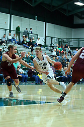17 November 2017:  Brady Rose cuts up the lane guarded by Preston Laketa during an College men's division 3 CCIW basketball game between the Alma Scots and the Illinois Wesleyan Titans in Shirk Center, Bloomington IL