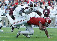 Nov 15, 2014; Tuscaloosa, AL, USA; Mississippi State Bulldogs defensive lineman Nelson Adams (94) tackles Alabama Crimson Tide wide receiver Amari Cooper (9) at Bryant-Denny Stadium. Mandatory Credit: Marvin Gentry