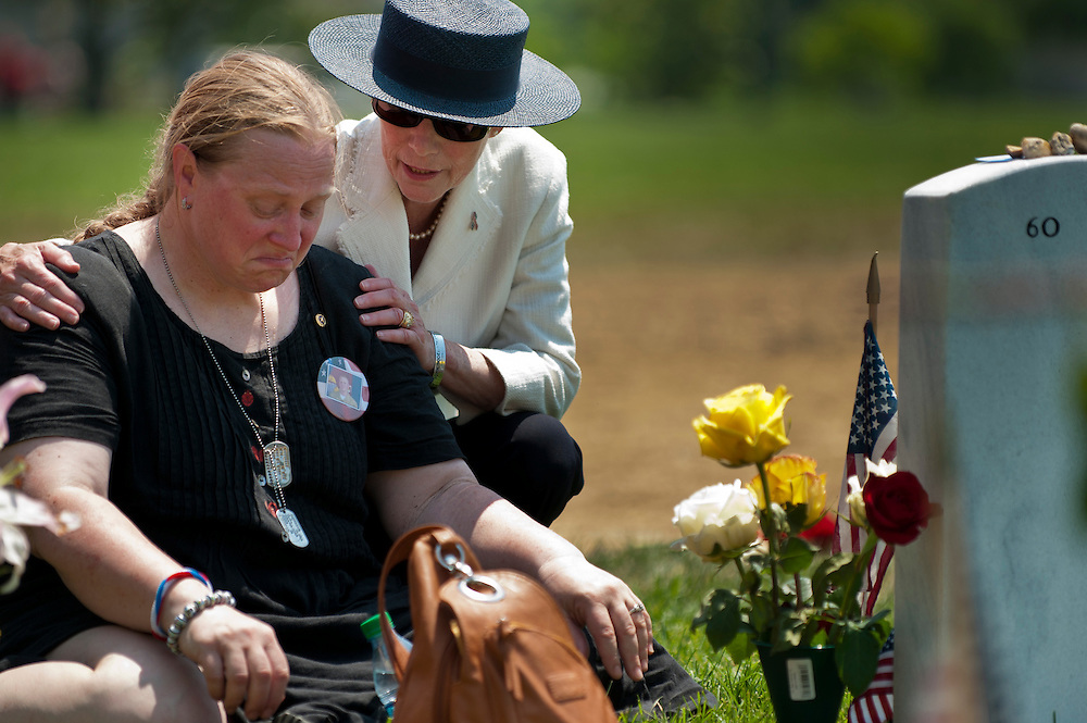 Kelly Hego of Princeton, MN, is comforted by DEBORAH MULLEN,  wife of Chairman of the Joint Chiefs of Staff Admiral Mike Mullen, during her visit with her husband to Section 60 at Arlington National Cemetery on Memorial Day.