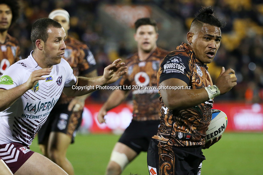 Warrior Solomone Kata, right is tackled by Manly's James Hasson in the NRL Rugby League, Warriors v Sea Eagles at Mt Smart Stadium, Auckland, New Zealand. 25 July 2015. Copyright Photo: Fiona Goodall / www.photosport.nz