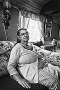 Monica Caldaras, Swedish Kalderash Roma, sitting in a traditional Roma wagon used for educational purposes