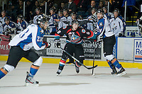 KELOWNA, CANADA, NOVEMBER 25: Colten Martin #8 of the Kelowna Rockets skates around Joey Leach #24 of the Kootenay Ice as the Kootenay Ice visit the Kelowna Rockets  on November 25, 2011 at Prospera Place in Kelowna, British Columbia, Canada (Photo by Marissa Baecker/Shoot the Breeze) *** Local Caption *** Colten Martin; Joey Leach;