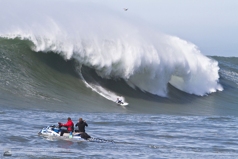 Carlos Burle surfs giant waves at the Mavericks Surf Contest held in Half Moon Bay, California on February 13, 2010