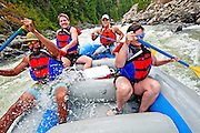 Elijah Weber, Mitchell Meade, Ryan Botoy and Teslin Brasseure whitewater rafting the Cabarton section on the North Fork of the Payette River which is rated Class 3 and located near the city of Cascade in central Idaho