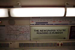 UK ENGLAND LONDON 1MAY12 - The newspaper you're reading is rubbish advertising sign on a Bakerloo line train on the underground.....jre/Photo by Jiri Rezac....© Jiri Rezac 2012