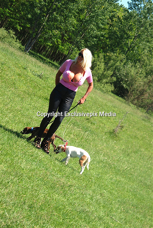 EXCLUSIVE<br /> <br /> Glamour model gran Sharon Perkins with 32MM breasts pictured in Bulgaria with her dogs as she takes a stroll in Bulgaria<br /> <br /> Photo shows: Sharon pictured walking her dogs in Bulgaria<br /> &copy;Exclusivepix Media