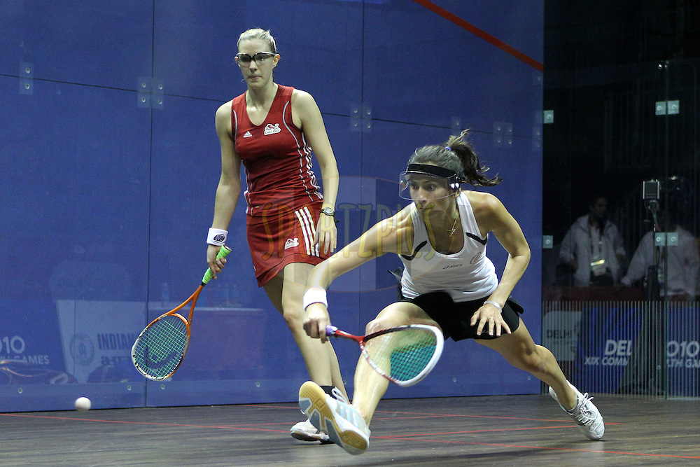 Joelle King of New Zealand and Laura Massaro of England during the final of the women's doubles squash competition held at the Siri Fort Complex in New Delhi as part of the XIX Commonwealth Games, India on the 13 October 2010..Photo by:  Ron Gaunt/photosport.co.nz