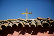 A cross tops the adobe wall at La Purisima Mission State Historic Park in Lompoc, Calif. © 2015 Nancy Wiechec