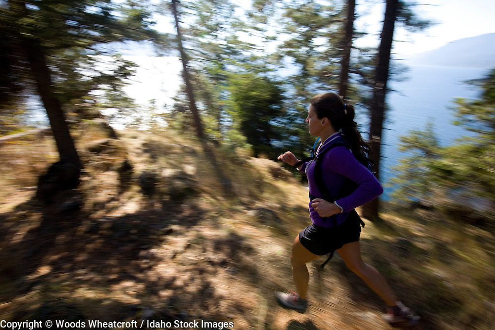 Suzanne Waldrup trail running at Mineral Point near Sandpoint, Idaho.