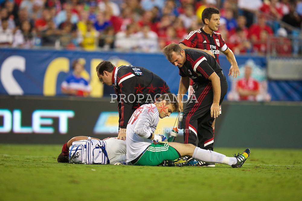CHARLOTTE, USA - Saturday, August 2, 2014: AC Milan's Mattia De Sciglio and goalkeeper Gabriel receive treatment after colliding during the International Champions Cup Group B match against Liverpool at the Bank of America Stadium on day thirteen of the club's USA Tour. (Pic by David Rawcliffe/Propaganda)