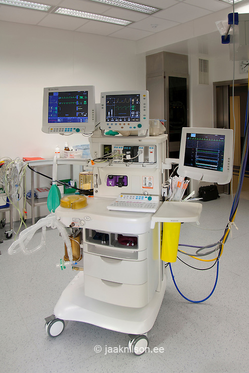Anaesthesia equipment, trolley, instrument trays and computer monitors.