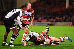 Gloucester Scrum-Half (#9) Dave Lewis is high tackled by Fiji Number 8 (#8) Nemani Nagusa during the second half of the match - Photo mandatory by-line: Rogan Thomson/JMP - Tel: Mobile: 07966 386802 13/11/2012 - SPORT - RUGBY - Kingsholm Stadium - Gloucester. Gloucester Rugby v Fiji - International Friendly