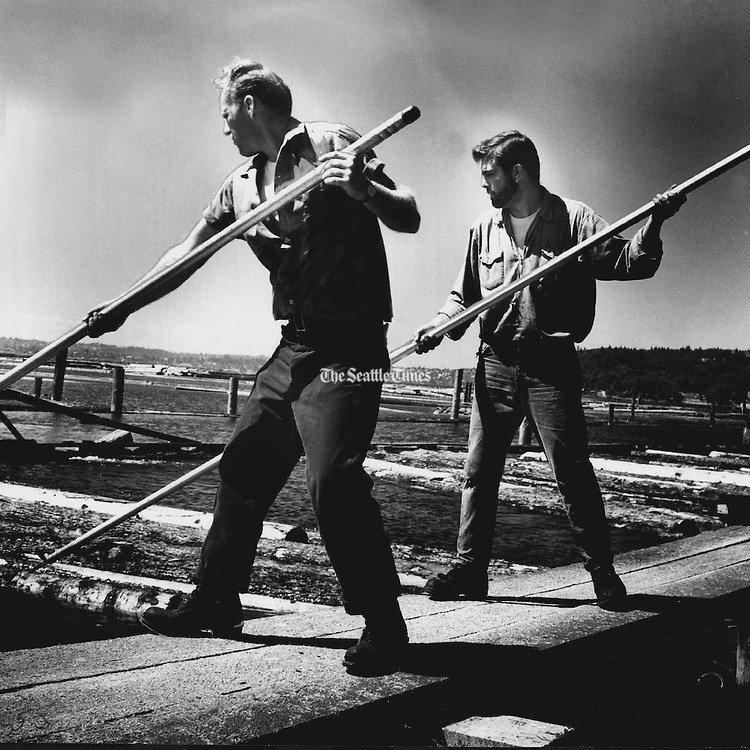 Crewmen use 14-foot aluminum pike poles to sort logs for bundling. (George Carkonen / The Seattle Times, 1970)