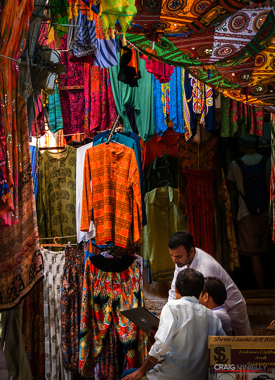 Fixing computer problems, in clothing market of Jaisalmer, India<br /> <br /> Nikon D750 85mm  ISO 2000  f14  1/80s