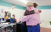 Eric Gebhardt hugs Danny Payne as they talk Tuesday, April 12, 2016 at Pegasus Records in Florence, Ala. about the store closing. Throughout the week regular customers such as Payne have come by to visit with Flippen and his employees. The store, which has been open for over 30 years, will close Saturday, April 16, 2016 on Record Store Day.
