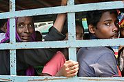 Rohingya refugees still unsure what lies ahead, leave the registration and aid distribution at the Cyclone Centre in Teknaf, Cox's Bazar region, Bangladesh - Photograph by David Dare Parker