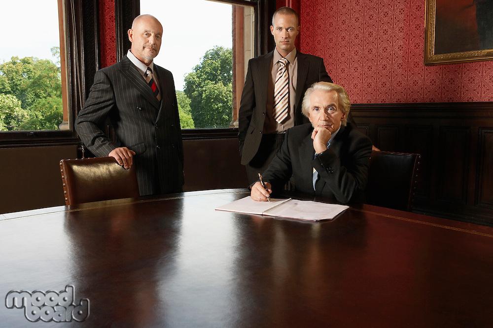 Three businessmen in boardroom