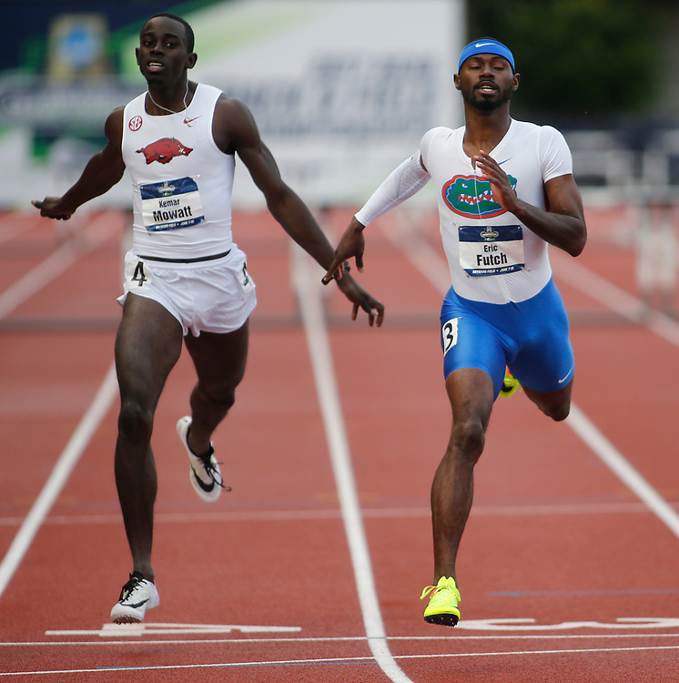 Florida's Eric Futch, right, crosses the finish line ahead of Arkansas' Kemar Mowatt, left, to win the men's 400 meters hurdles in the time of 48.32 seconds on the third day of the NCAA outdoor college track and field championships in Eugene, Ore., Friday, June 9, 2017. Mowatt finished third in the time of 48.49 seconds. (AP Photo/Timothy J. Gonzalez)