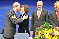 Herman Van Rompuy, Belgium's prime minister, and the first president of Europe, left, gives a kiss to Catherine Ashton, Europe's new foreign minister, center, as Fredrik Reinfeldt, Sweden's prime minister and standing president of the European Council, and Jose Manuel, Barroso, president of the European Commission, right look on, during the press conference following the European Union Summit at the EU headquarters in Brussels, Belgium, on Thursday, Nov. 19, 2009. European leaders set divisions aside today as they chose their first-ever European Union president to represent the 27-nation bloc on the world stage. (Photo © Jock Fistick)