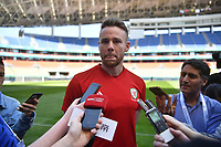 Chris Gunter of Wales national football team is interviewed in a training session before the semi-final match against China during the 2018 Gree China Cup International Football Championship in Nanning city, south China's Guangxi Zhuang Autonomous Region, 20 March 2018.
