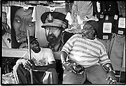 Street vendors sitting in front of posters former Ethiopia king Haile Selassie, revered by Rastafarians.