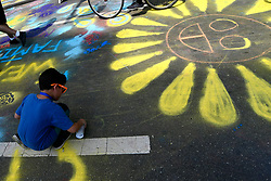 North Broad St. becomes a canvas for young and old duding the Philly Free Streets, on Saturday. (Bastiaan Slabbers for WHYY)