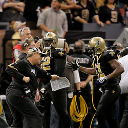 Nov 08, 2009; New Orleans, LA, USA; New Orleans Saints defensive coordinator Gregg Williams celebrates with linebacker Jonathan Vilma (51) after a defensive touchdown in the fourth quarter against the Carolina Panthers at the Louisiana Superdome. The Saints defeated the Panthers 30-20. Mandatory Credit: Derick E. Hingle