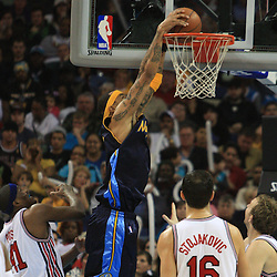 28 January 2009:  Denver Nuggets forward Kenyon Martin (4) dunks the ball during a 94-81 win by the New Orleans Hornets over the Denver Nuggets at the New Orleans Arena in New Orleans, LA. The Hornets wore special throwback uniforms of the former ABA franchise the New Orleans Buccaneers for the game as they honored the Bucs franchise as a part of the NBA's Hardwood Classics series. .