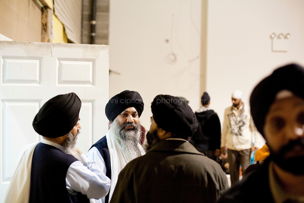 13 February, 2009.Bellerose, Queens, NY.  Sikh members of the Gurdwara Sagar Temple gather for the Langar after prayers, a meal distributed to everybody as a symbol of equality. The Gurdwara Sagar  temple is still in construction and is planned to be completed by mid-April. The temple has been built next to the Veterans of Foreign Wars Hall in Bellerose, Queens, where demographics have changed in recent year.<br /> <br /> <br /> &copy;2009 Gianni Cipriano for The New York Times<br /> cell. +1 646 465 2168 (USA)<br /> cell. +1 328 567 7923 (Italy)<br /> gianni@giannicipriano.com<br /> www.giannicipriano.com