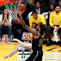 30 March 2018: Los Angeles Lakers forward Brandon Ingram (14) goes for the layup past Milwaukee Bucks center Tyler Zeller (44) during the Milwaukee Bucks 124-122 victory over the LA Lakers, at the Staples Center, Los Angeles, California, USA.