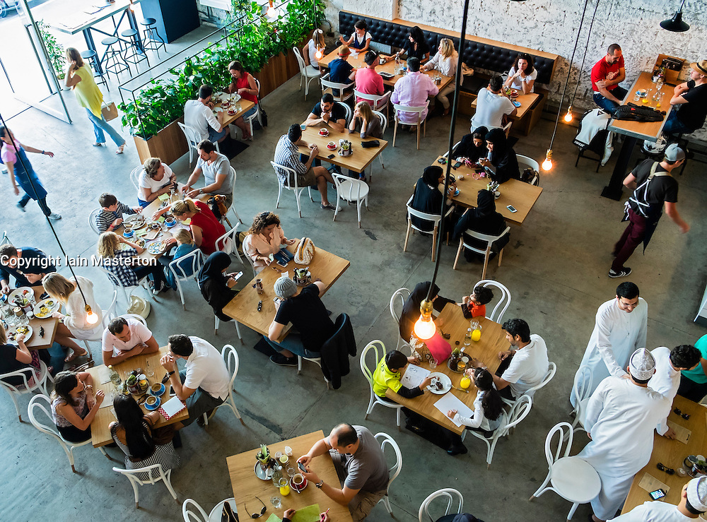 Interior of busy Tom and Serg cafe in Al Quoz district of Dubai United Arab Emirates