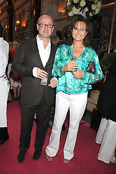 Australian award winning jewellery designer John Calleija and special guest Claudia Schiffer hosted the launch party of Calleija's new London store in the Royal Arcade, Old Bond Street, London on 24th June 2008.<br /><br />Picture shows:- SEBASTIAN SAINSBURY and HENRIETTA, COUNTESS OF CALEDON