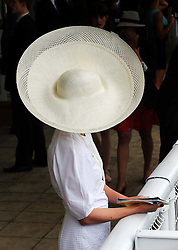 A racegoer on the second day of Glorious Goodwood in the UK, Wednesday, 31st July 2013<br /> Picture by Stephen Lock / i-Images