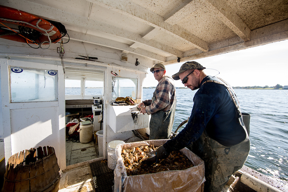 Ryan Ribb adds more food to the crab trap before throwing it back in the water | October 11, 2015