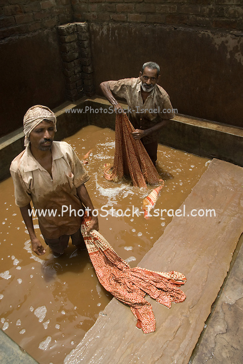 India, Rajasthan, Pushkar, Block-printing involves printing of cloth with carved wooden blocks. Then dyeing the cloth to a selected colour. The manual dyeing process