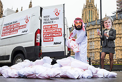 © Licensed to London News Pictures. 06/03/2018. London, UK. Campaigners wearing masks of Saudi Crown Prince Mohammad bin Salman and Prime Minister Theresa May protest against the sale of British weapons to Saudi Arabia for use in the ongoing war in Yemen. Campaigners report that the UK sold more than £1.1bn worth of arms and military equipment to Saudi Arabia in the first six months of 2017. Photo credit: Rob Pinney/LNP