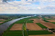 Nederland, Brabant, Gemeente Waspik, 09-05-2013; Overdiepsche polder: in het kader van het programma 'Ruimte voor de Rivier' (bescherming tegen hoogwater door rivierverruiming), zal de dijk langs de Bergsche Maas (links in beeld) verlaagd worden. Bij hoogwater kan de Overdiepse polder overstromen. De boerderijen in de polder worden gesloopt en verplaatst naar de dijk van het Oude Maasje. De nieuwe boerderijen met bijgebouwen komen op terpen.<br /> Depoldering of Overdiep Polder, farms are relocated and built on mounds. This makes it possible for the river to overflow the polder in case of heigh waters.<br /> luchtfoto (toeslag op standard tarieven);<br /> aerial photo (additional fee required);<br /> copyright foto/photo Siebe Swart.