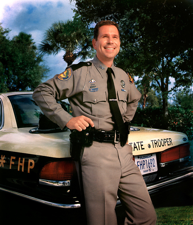 Florida Turnpike Annual Report, enviromental portrait of FHP officer Williams.