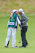 Mark Calcavecchia kisses his wife/caddy on the 18th green after completing the final round of the Rolex Senior Golf Open at St Andrews, West Sands, Scotland on 29 July 2018. Picture by Malcolm Mackenzie.